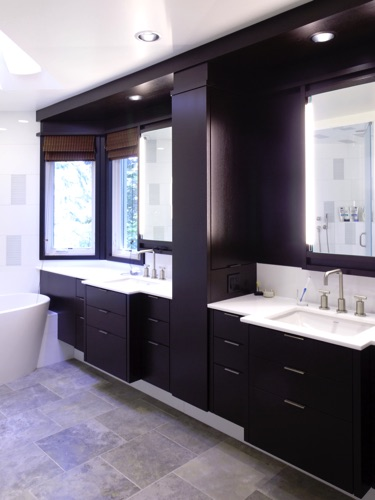 His & Her vanities separated by medicine cabinet tower. Cabinets are mahogany.
